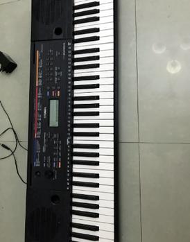 Yamaha piano PSR E263 1