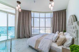 غرفة وصالة وحمامين بموقع متميز في عجمان