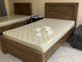Two beds with bedding for sale