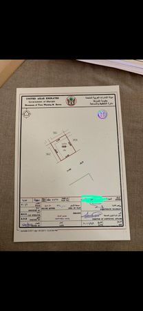 A plot of land in the UAE between the Emirate of Sharjah and...