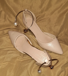 Used beige high heels