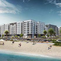own an apartment on Sharjah Beach