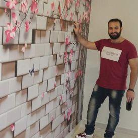 نقاش سوري اعمال الدهانات والديكورات الحديثة