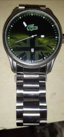 Lacoste watch green face