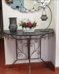 Metal consol with mirror and two candles