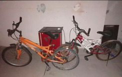 Mountain sports bike orange for 15 bd and white for 25 bd